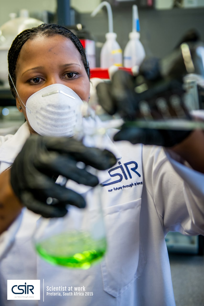 Women scientist at work with mask