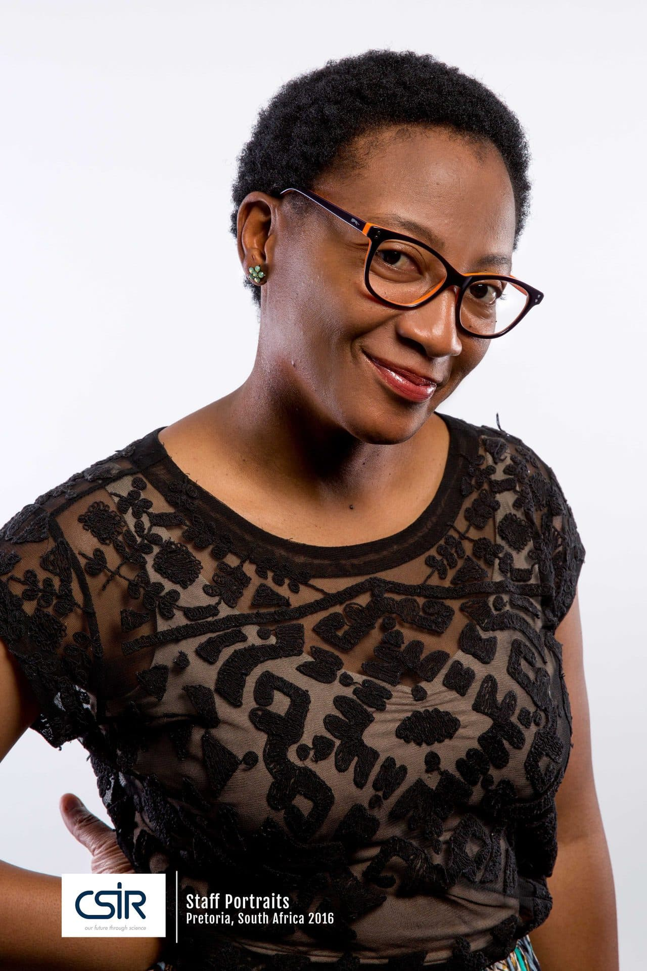 Portraits of  CSIR Staff - Black women with glasses and black top