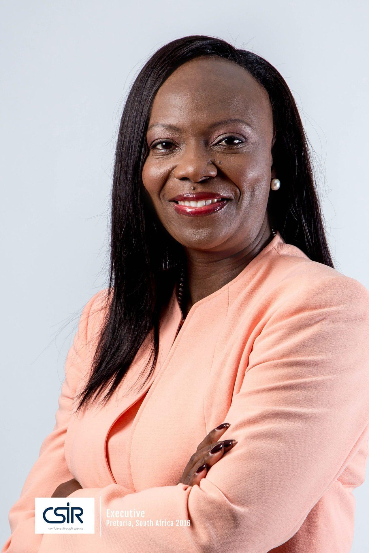 Black Women Executive in Pink Jacket